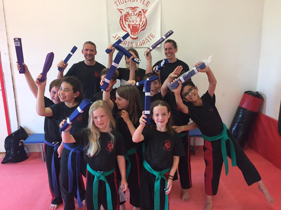 Children and adults after grading for their blue and purple belts
