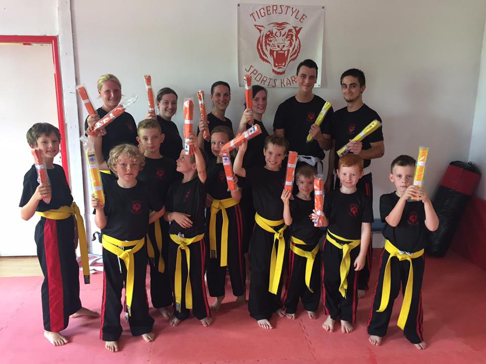 Children and adults after grading for their yellow and orange belts