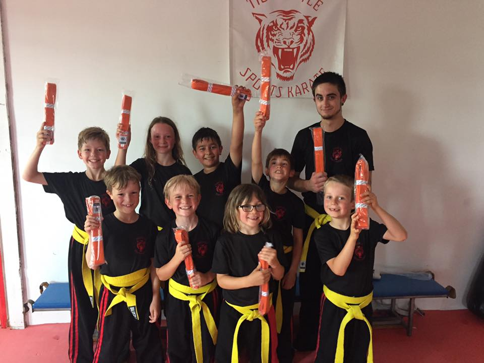 Children and adults after grading for their orange belts