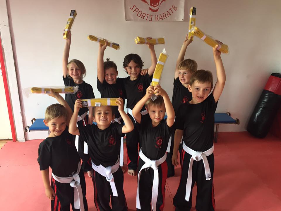 Children after grading with their yellow belts