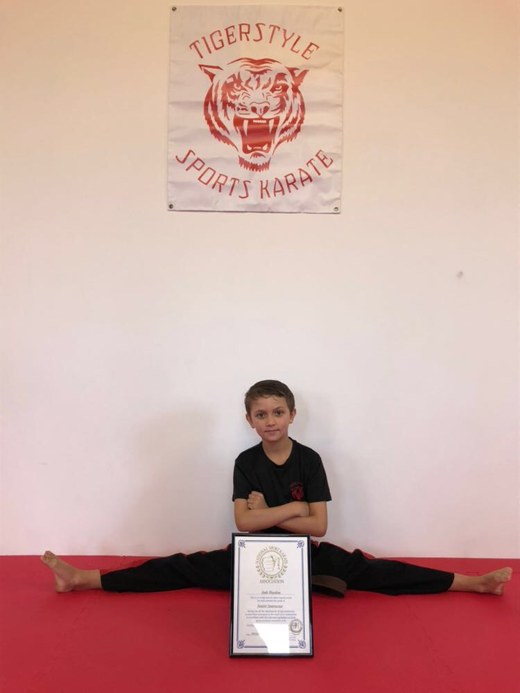 Josh with instructors certificate