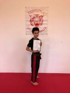 Abdullah with instructors certificate
